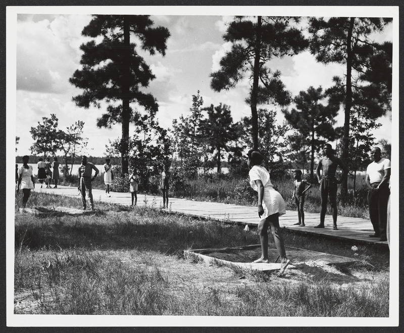 Photograph of families playing horseshoes at Reedy Creek State Park