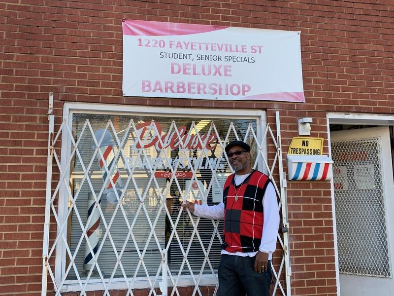 Derrick Green in Front of DeLuxe Barbershop