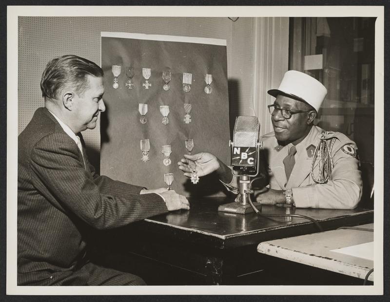 Photograph of Eugene Bullard during a radio interview