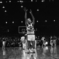 Bob Cunningham shooting from foul line during pre-game practice versus South Carolina for the A.C.C.Tournament championship, Reynolds Coliseum, Raleigh, 1957.