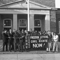 Photograph, Marchers gather in front of the Franklin Street post office