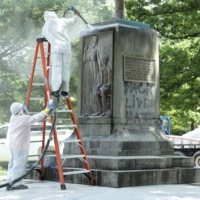 Workers clean the monument, 2015
