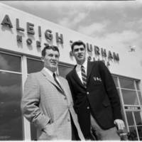 Frank McGuire and Lennie Rosenbluth at Raleigh-Durham airport, 1957.