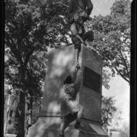 Students climbing Silent Sam, circa 1939-1942
