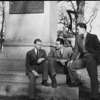 Students sit at the base of Silent Sam, circa 1939-1942