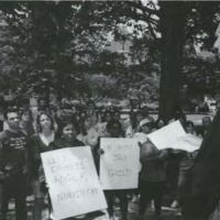 Chancellor Paul Hardin addresses demonstrators at Silent Sam during the L.A. Riots, 1992