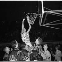 Lennie Rosenbluth Dixie Classic. Cutting down the net.